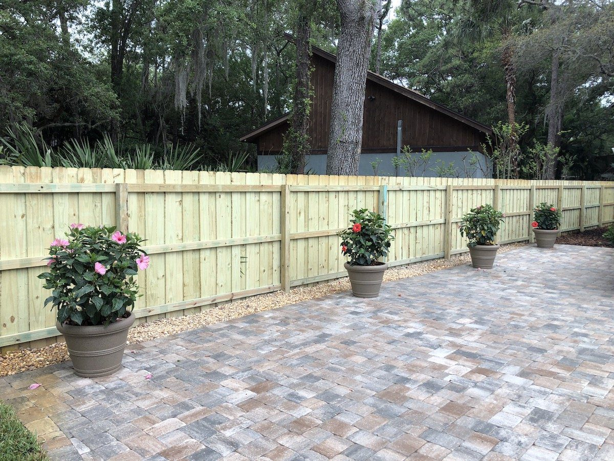 fence installation and paver patio by professor green thumb